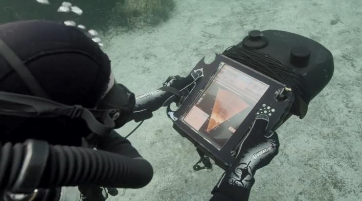 EOD diver with handheld sonar